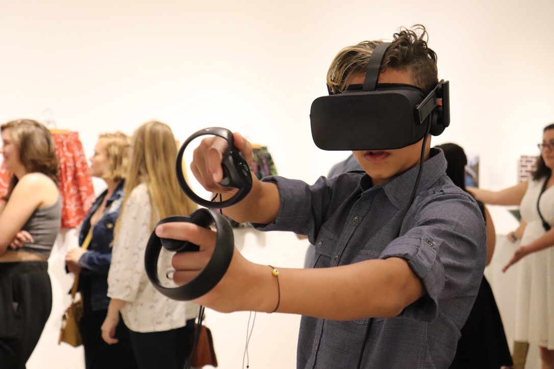 Those in attendance at the Digital Arts reception had the opportunity to engage in several student works, including a VR set-up by Alex Ramirez.