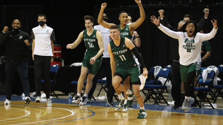Freshman Chase Johnston and the Hatter bench celebrate after an opening round win in the 2021 CBI. Courtesy of Stetson Athletics.